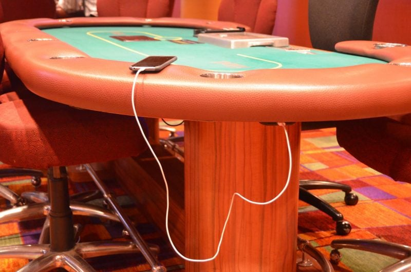 casino game table with builtin charging power source