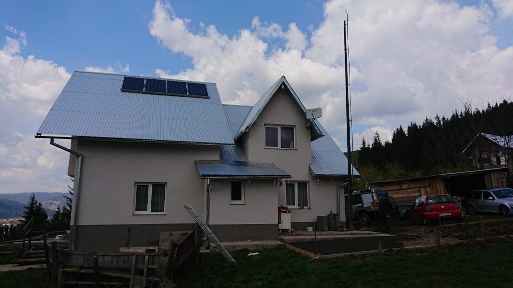 solar panels on a remote house in romania mountains